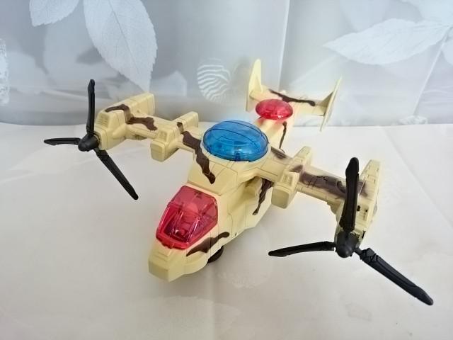 Вертолёт на батарейках (ездит, музыка играет), 22 х 19 х 8 см, пластмасса.