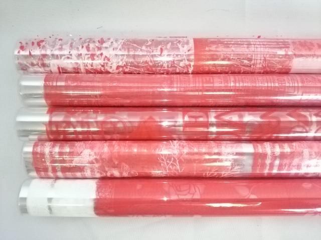 Плёнка прозрачная 70 см в рулоне с двухцветным рисунком красная в ассортименте.