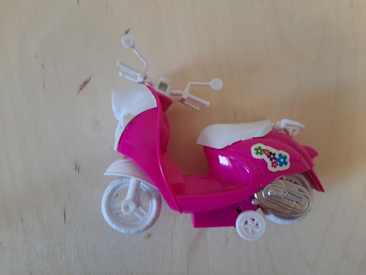 Мотоцикл для кукол розовый, 13*11 см.